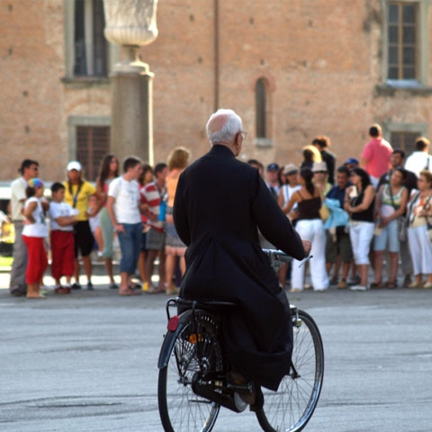 Priest Riding a Bicyle in Vatican City