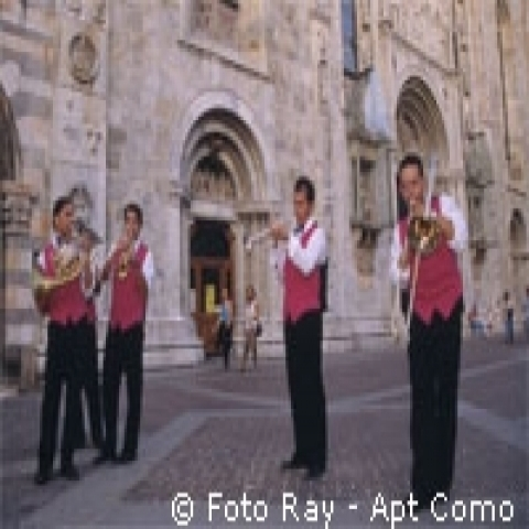 Musicians playing in the city center of Como Italy