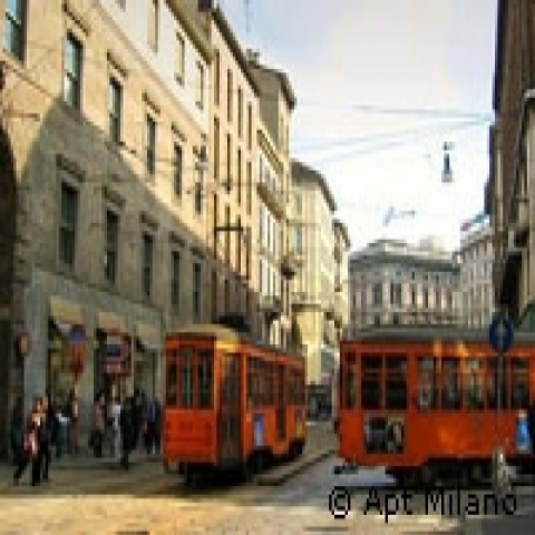 Vintage trams in Milan historical center Italy