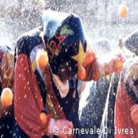 Orange throwing at the Ivrea Carnival Piedmont Italy