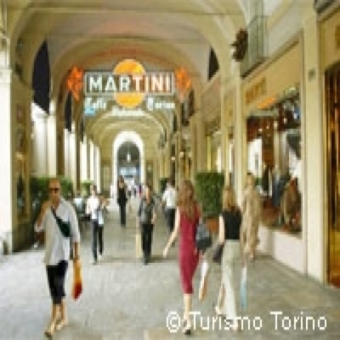 Shopping under the arcades of the center of Turin Italy