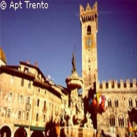 The lively cathedral square in Trento Italy