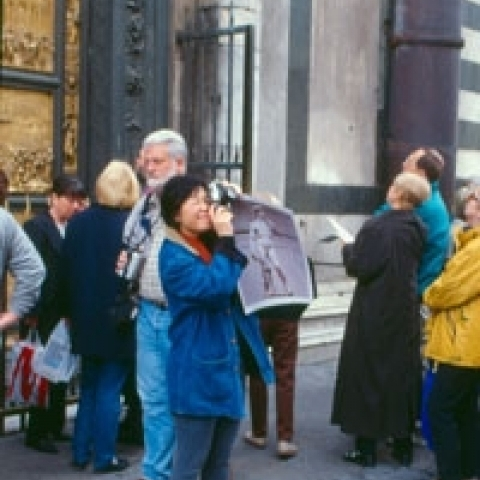 Tourists outside Baptistery in Florence Tuscany Italy