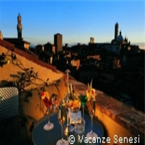 Cocktail with view of Siena towers Tuscany Italy