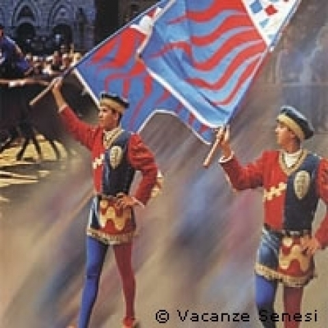 Flag flyers during Palio of Siena Tuscany Italy