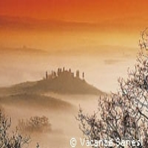 A foggy sunrise in Val D'Orcia Tuscany Italy