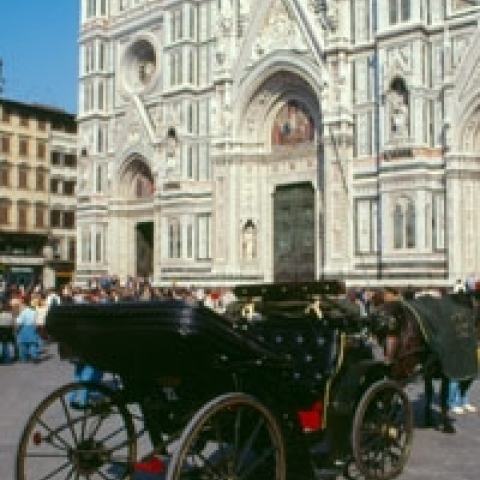Horse-drawn carriage in front of Florence Cathedral Italy