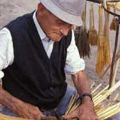 Artisan working with the straw in Padua countryside Italy