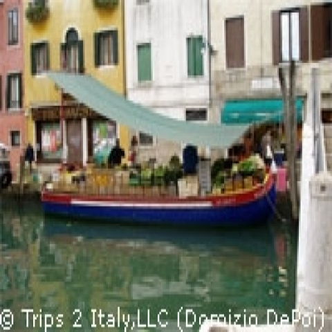 Colorful boat on the canal Venice Italy