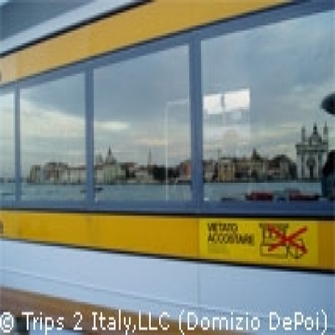 Venice reflected on the Vaporetto station Italy