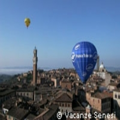 A hot air baloon over Siena Italy
