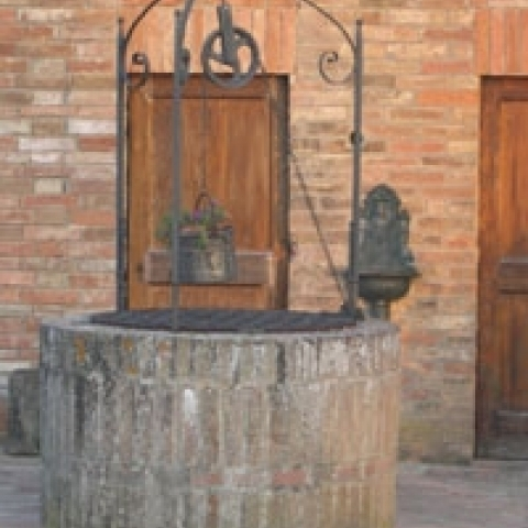 A well in a Siena courtyard Italy