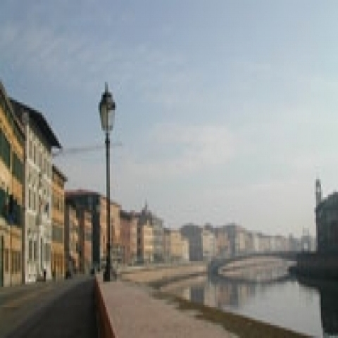 A view of Arno river flowing in Pisa Italy