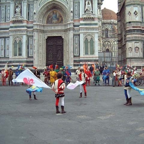 Flag flyers in front of Florence Cathedral Italy